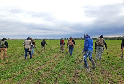 A group of metal detectors practice the metal detecting code of ethics as they hunt.