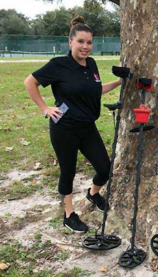 Shelby from Kellyco Metal Detectors standing near tree
