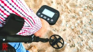 Metal Detecting In The Dry Sand