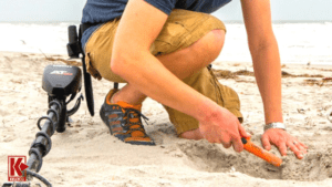 A detectorist using a Garrett AT Max detector and Pro-Pointer AT with Z-Lynk on the beach