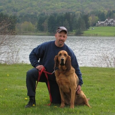 Mitch Serlin, founder of Hope for Heroes, poses with his dog.